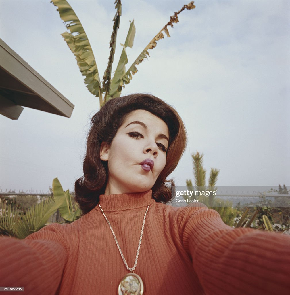 Portrait of American actress Annette Funicello (1942 - 2013) as she clowns around for the camera, 1965.