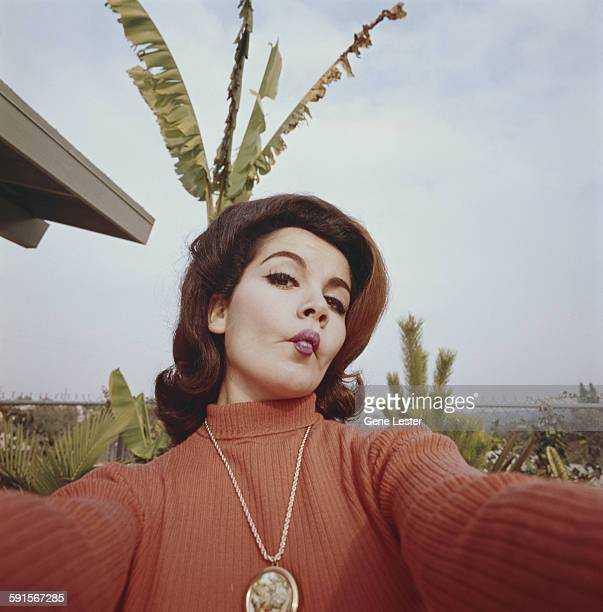 Portrait of American actress Annette Funicello as she clowns around for the camera 1965