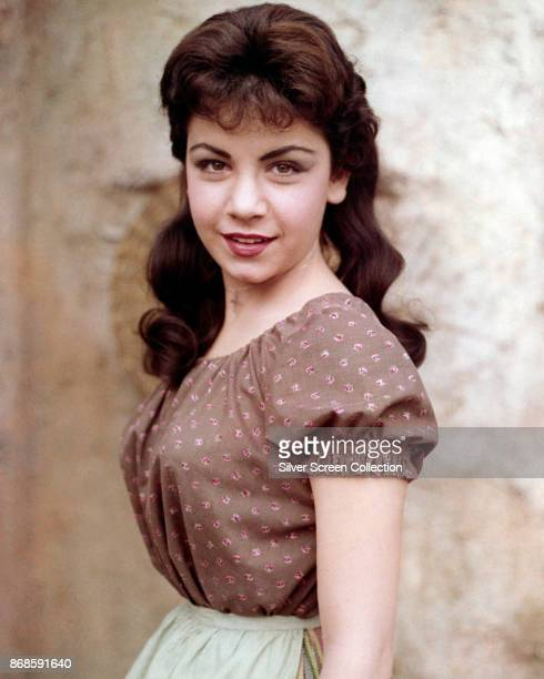 Portrait of American actress Annette Funicello as she poses in a brown blouse with red print flowers early 1960s