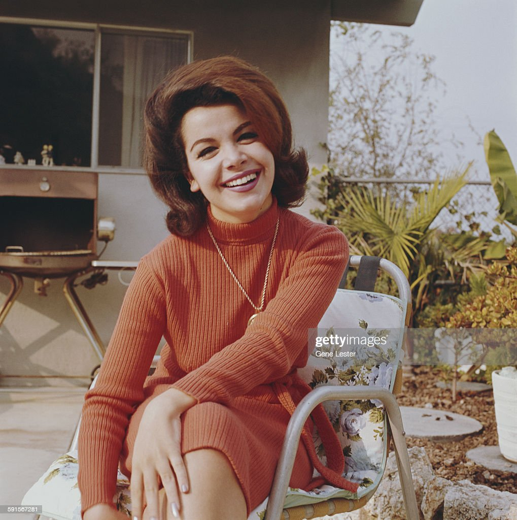Portrait of American actress Annette Funicello (1942 - 2013) as she sits outdoors, 1965.