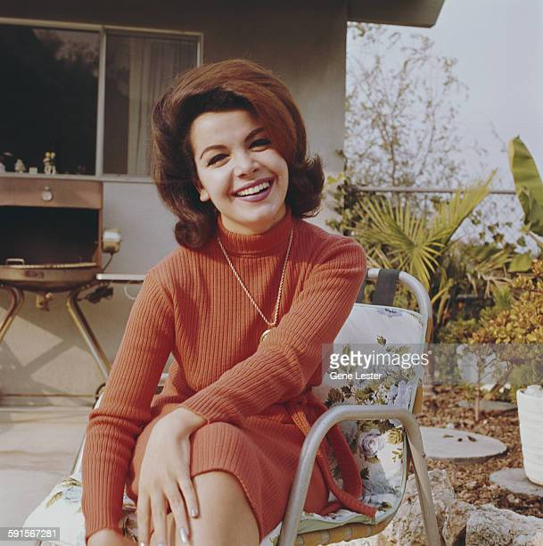 Portrait of American actress Annette Funicello as she sits outdoors 1965