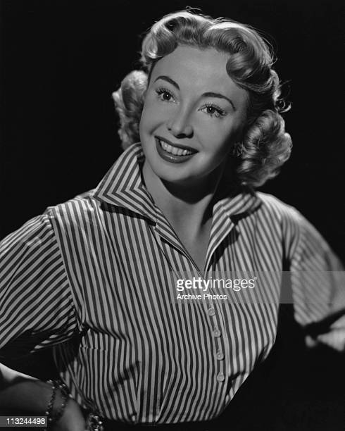 Portrait of American actress Audrey Meadows wearing a striped shirt in 1957