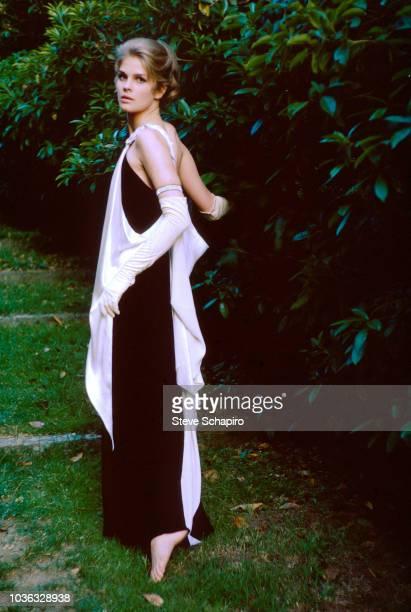 Portrait of American actress Candice Bergen , barefoot in an evening gown and elbow gloves, on the set of the film 'The Group' , 1966.