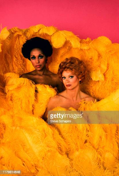 Portrait of American actress Diahann Carroll and Indianborn American Juliet Prowse as they poses together surrounded by oversize yellow feathers Los...