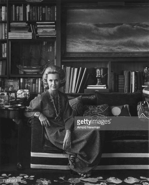 Portrait of American actress Dina Merrill as she sits on a sofa December 1974