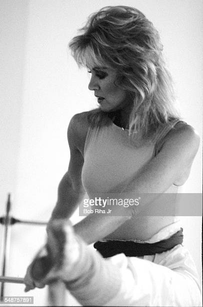 Portrait of American actress Donna Mills as she performs barre exercises in her home dance studio Beverly Hills California March 18 1983