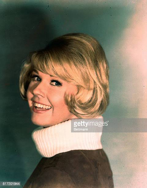 Portrait of American actress Doris Day smiling broadly.