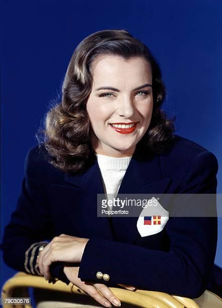 1953 Portrait of American actress Ella Raines wearing a smart blazer jacket