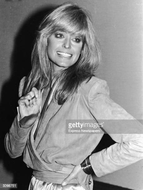 Portrait of American actress Farrah Fawcett at a photocall promoting her film 'Saturn 3' directed by Stanley Donen England 1980