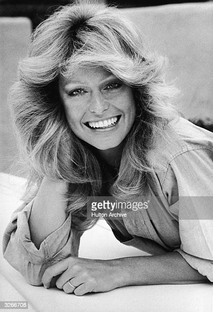 Portrait of American actress Farrah Fawcett in a denim shirt 1980s