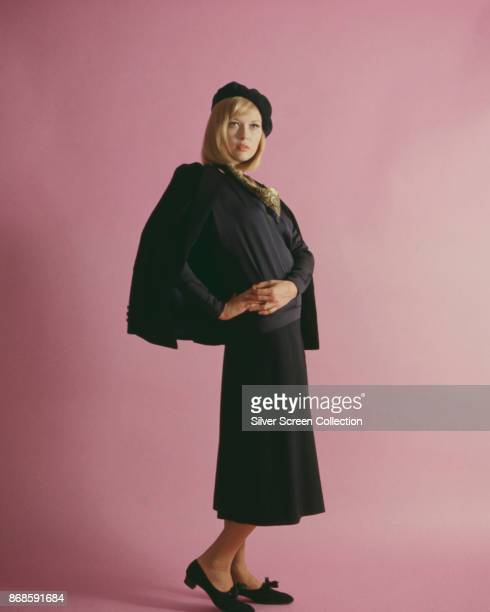 Portrait of American actress Faye Dunaway as she poses before a pink background for 'Bonnie and Clyde' 1967
