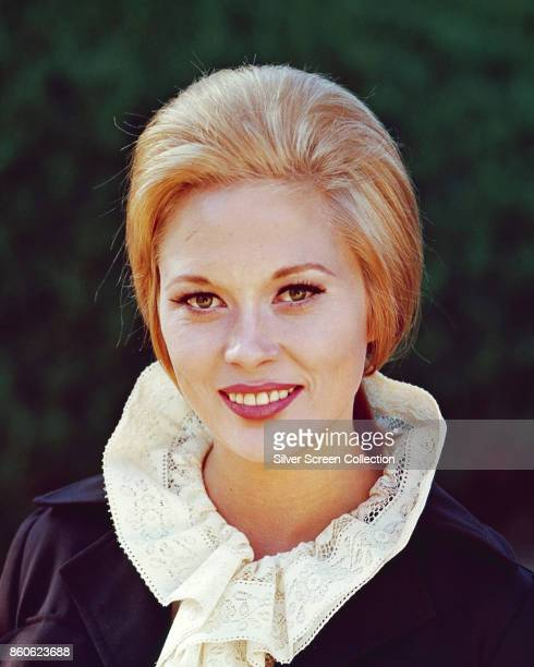 Portrait of American actress Faye Dunaway as she poses outdoors 1960s or early 1970s