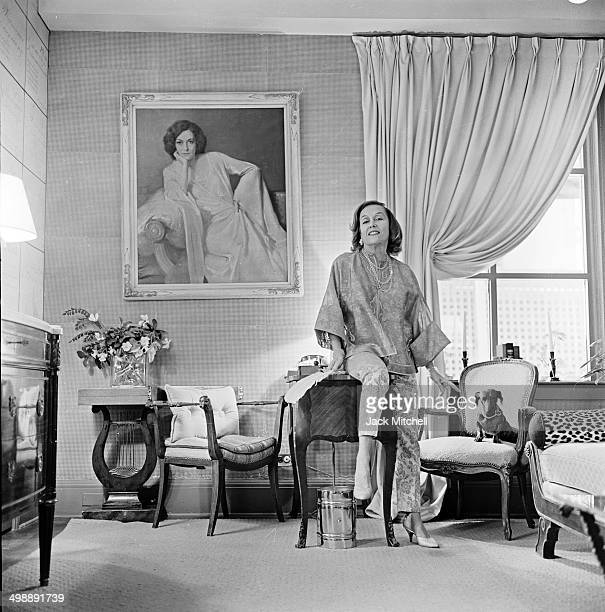 Portrait of American actress Gloria Swanson as she poses in the living room of her home New York New York 1962
