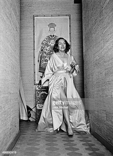 Portrait of American actress Gloria Swanson in a dressing gown as she poses in the hallway of her home New York New York 1960