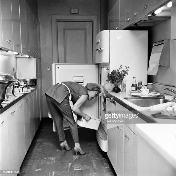 Portrait Of American Actress Gloria Swanson In The Kitchen