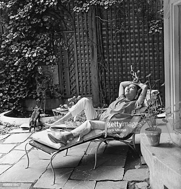 Portrait of American actress Gloria Swanson on the private patio of her home New York New York 1960