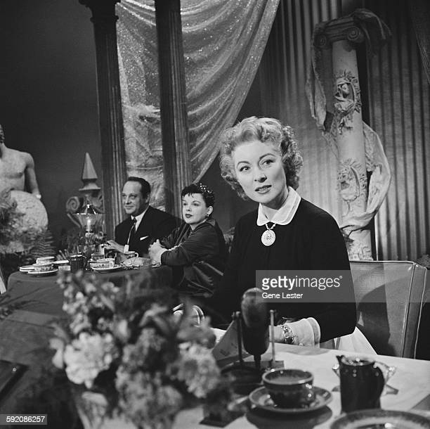Portrait of American actress Greer Garson as she sits at a table at the 27th Academy Award nominations event Burbank California February 12 1955...