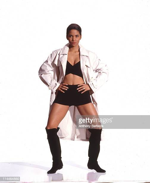 Portrait of American actress Halle Berry as she poses with her hands on her hips 1990