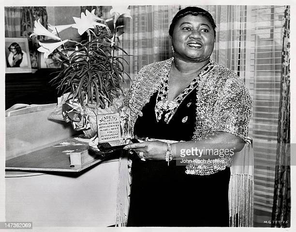 Portrait of American actress Hattie McDaniel holding her Academy Award from the film 'Gone With the Wind' 1940