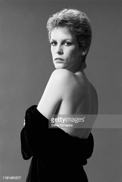 Portrait of American actress Jamie Lee Curtis as she poses with her shoulders bared Los Angeles California 1983