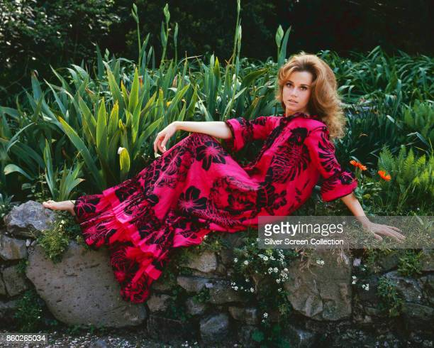Portrait of American actress Jane Fonda as she poses outdoors late 1960s