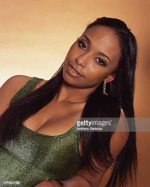 Portrait of American actress Jazsmin Lewis as she poses in a metallic green dress New York New York 2003