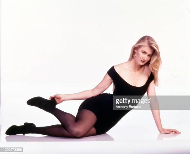 Portrait of American actress Laura Dern as she poses against a white background 1990