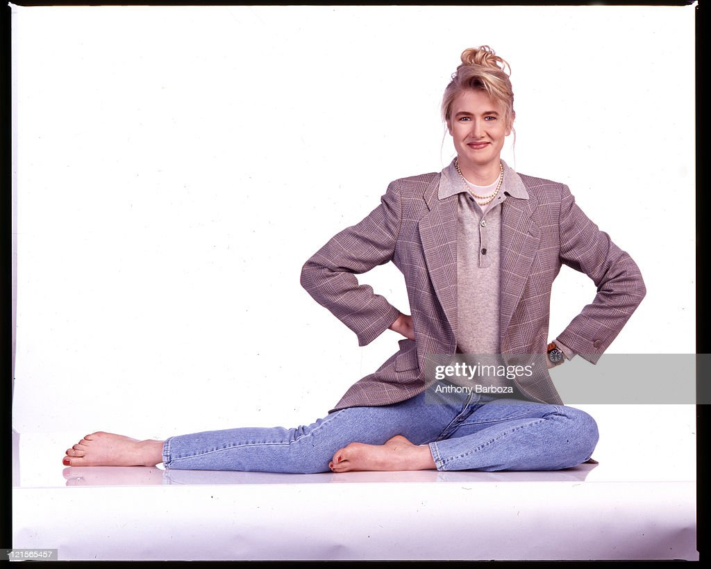 Portrait of American actress Laura Dern as she sits against a white background, 1990.