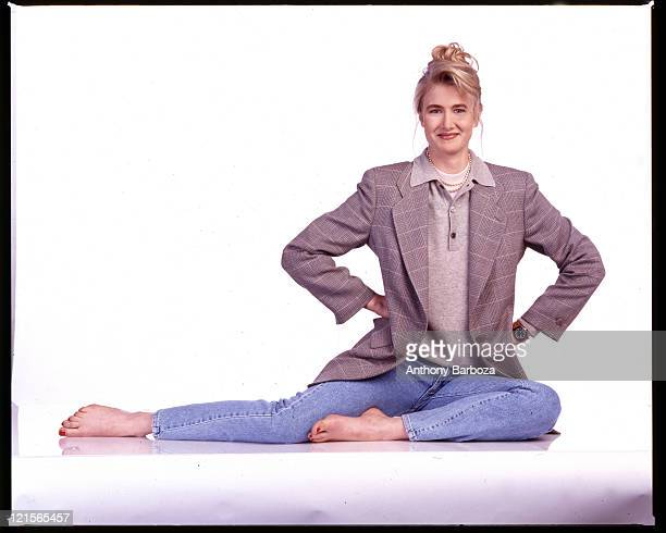 Portrait of American actress Laura Dern as she sits against a white background 1990