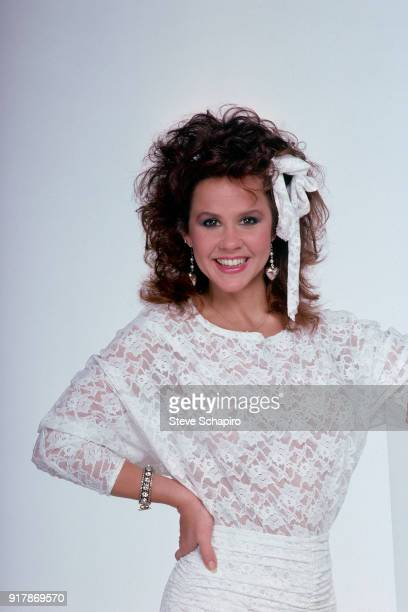 Portrait of American actress Linda Blair dressed in a white lace top as she poses against a white background Los Angeles California 1985