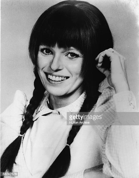 Portrait of American actress Louise Lasser smiling with her hair in pigtails as the titular character on the shortlived nighttime serial 'Mary...