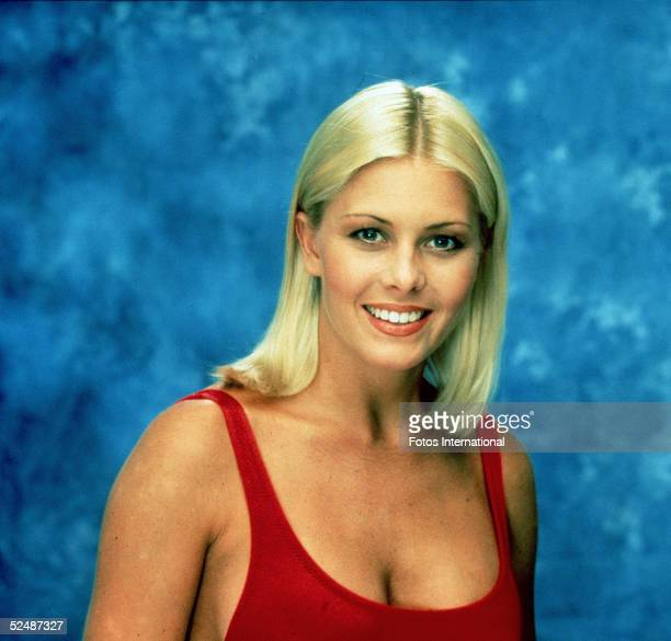 Portrait of American actress Nicole Eggert, one of the stars of the tv series 'Baywatch,' wearing a low-cut red swimsuit, 1992.