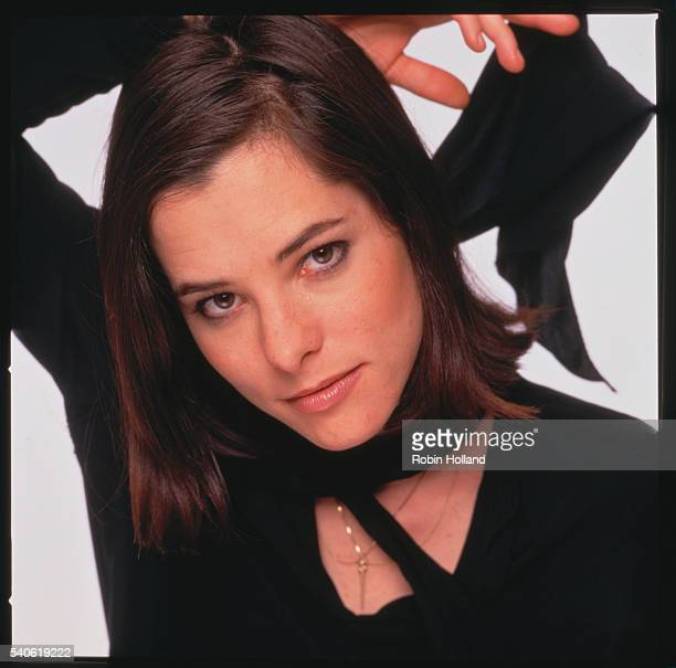 Portrait of American actress Parker Posey as she poses against a white background late 1990s or early 2000s