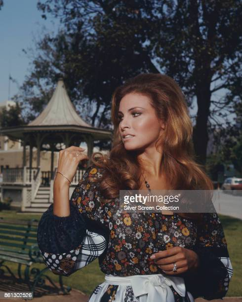 Portrait of American actress Raquel Welch as she poses in front of a gazebo in a small park, Los Angeles, California, June 19, 1969. She filmed an...