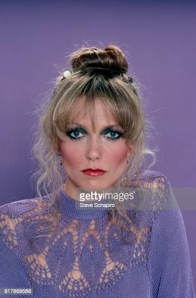 Portrait of American actress Susan Blakely in a violet crocheted top as she poses against a violet background Los Angeles California 1979