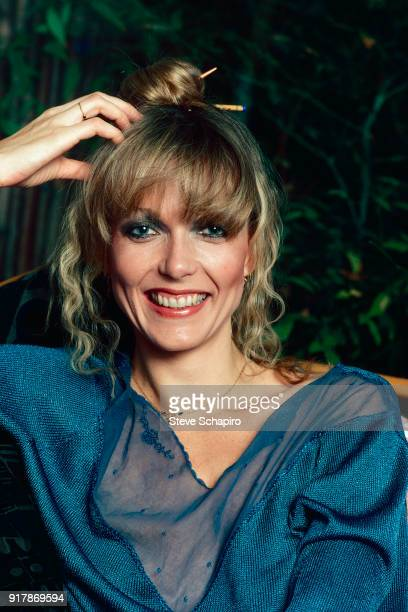 Portrait of American actress Susan Blakely one hand on her head as she smiles and poses outdoors Los Angeles California 1979