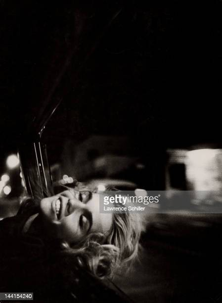 Portrait of American actress Tuesday Weld as she leans her head put of a car window Los Angeles California June 1963