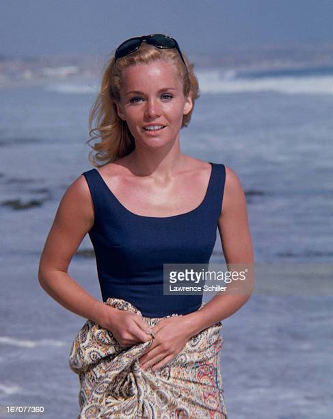 Portrait of American actress Tuesday Weld as she poses in a swimsuit on a beach Los Angeles California 1963 The picture was taken during a photo...