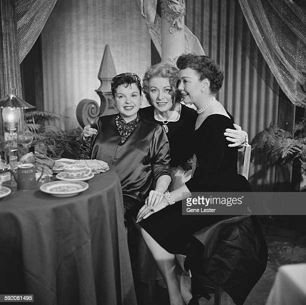 Portrait of American actresses from left Judy Garland Greer Garson and Jane Wyman as they pose together at the 27th Academy Award nominations event...