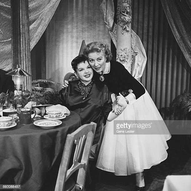 Portrait of American actresses Judy Garland and Greer Garson as they pose together at the 27th Academy Award nominations event Burbank California...