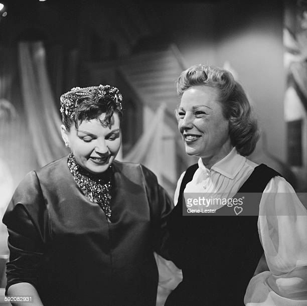 Portrait of American actresses Judy Garland and June Allyson as they pose together at the 27th Academy Award nominations event Burbank California...