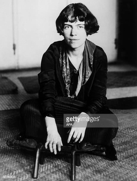 Portrait of American anthropologist Dr Margaret Mead assistant curator of the American Museum of Natural History wearing a dress and sitting...