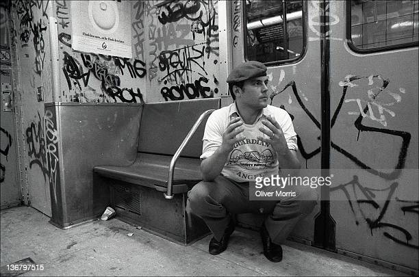 Portrait of American anticrime activist and founder of the Guardian Angels Curtis Sliwa as he crouches next to the door of a subway car New York New...