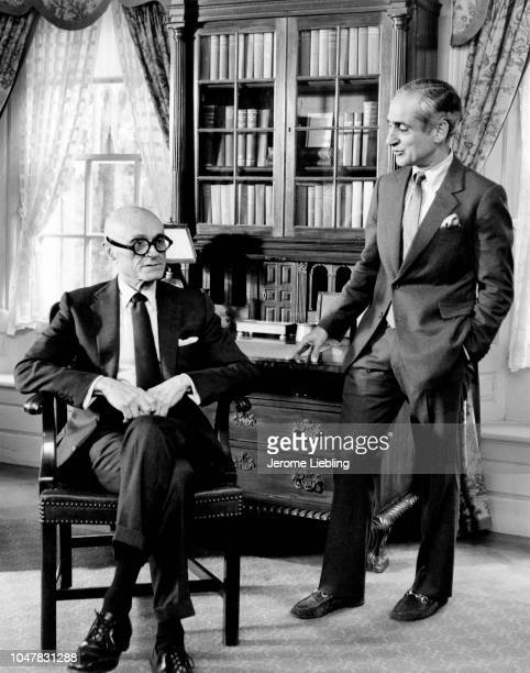 Portrait of American architects Philip Johnson and Robert AM Stern as they pose together in the HillStead Museum Farmington Connecticut 1984