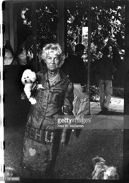 Portrait of American art collector Peggy Guggenheim as she poses with her pet dog under her arm as she poses in her villa Venice Italy August 23 1961
