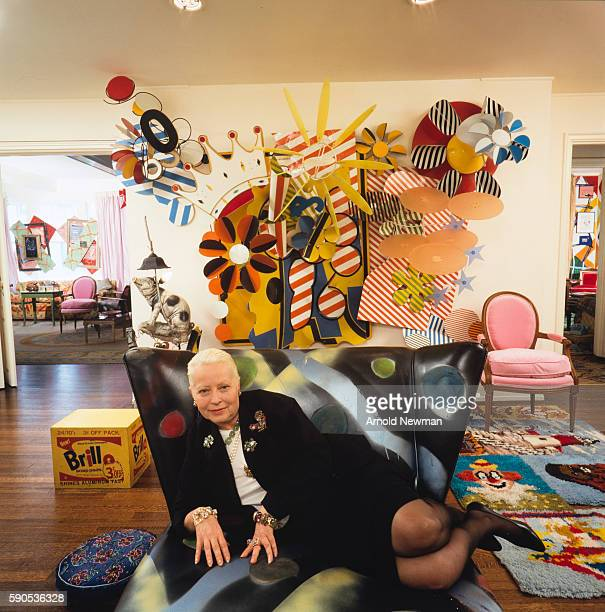 Portrait of American art dealer and collector Holly Solomon as she poses on a couch surrounded by modern and Pop art New York New York May 20 1988...