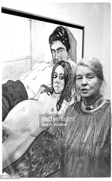 Portrait of American artist Alice Neel as she poses in front of one her painting at the opening of her show at the Graham Galley New York New York...