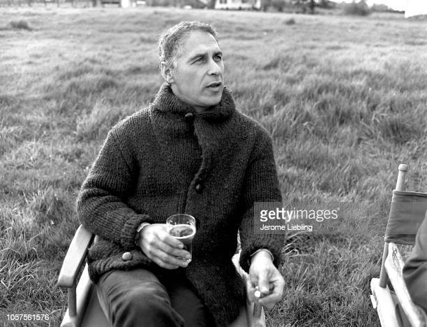 Portrait of American artist and filmmaker Alfred Leslie as he sits in a chair in a field outside his home in Amherst Massachusetts May 1976 He wears...