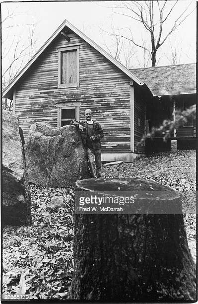 Portrait of American artist and sculptor H C Westermann as he leans against a large rock outside his studio Connecticut May 9 1978