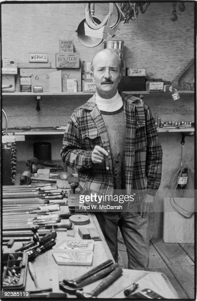 Portrait of American artist and sculptor H C Westermann as he stands in his studio a cigar in his hand Connecticut May 9 1978
